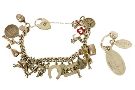 A key chain by Tiffany & Co. and silver charm bracelet