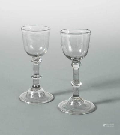 A pair of George III wine glasses,