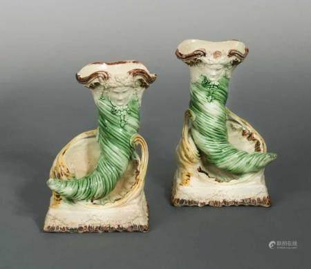 A rare pair of 18th century Staffordshire cornucopia vases,