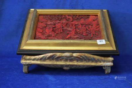CARVED FRAMED CHINESE RED LAQUER PANEL ON GOLD WOODEN STAND,