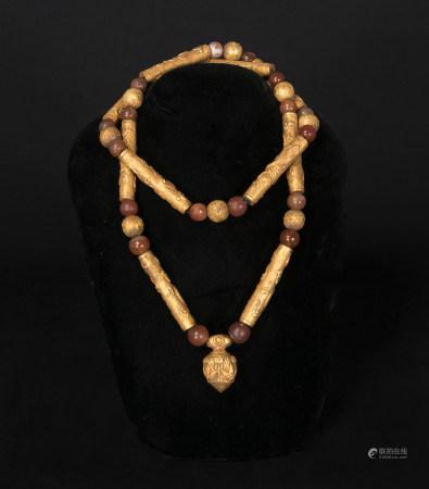 遼代-金心形墜龍紋管珠鍊