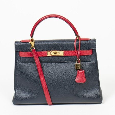 HERMÈS | NAVY BLUE AND RED EPSOM KELLY RETOURNE BICOLOR 32 WITH GOLD HARDWARE