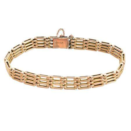 A 9ct gold bracelet by Charles Daniel Broughton,