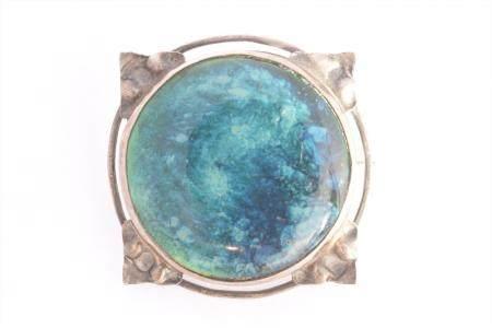 An Arts & Crafts enamel brooch,
