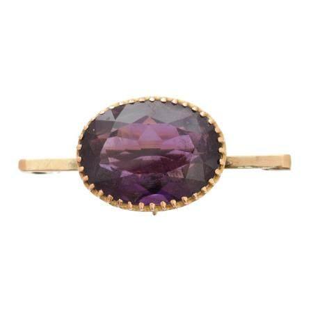 An amethyst brooch,