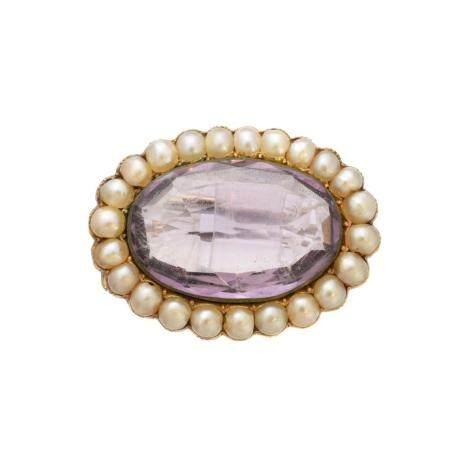 An amethyst and split pearl brooch,