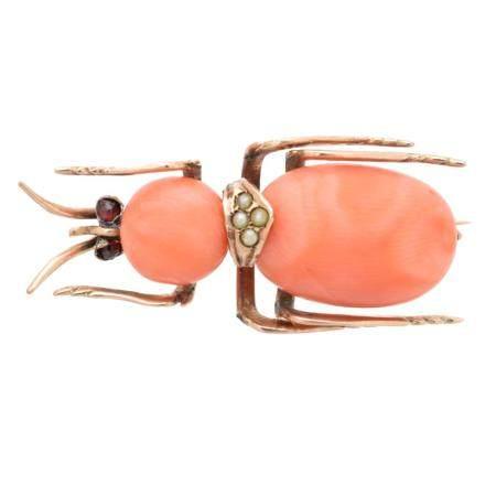 A coral bug brooch,