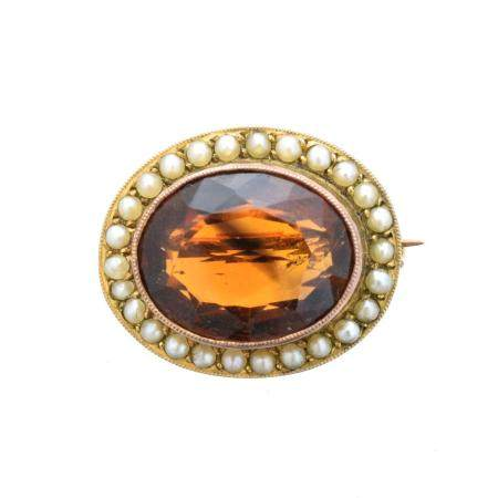 A citrine and split pearl brooch,