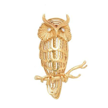 A 1970s 18ct gold owl brooch,