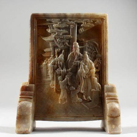 A SMALL CHINESE CARVED JADE TABLE SCREEN. 7.5ins high.