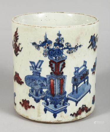 A CHINESE PORCEAIN BRUSH POT, painted in blue and red, with