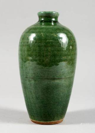 A CHINESE GREEN GLAZED POTTERY VASE. 7ins high.