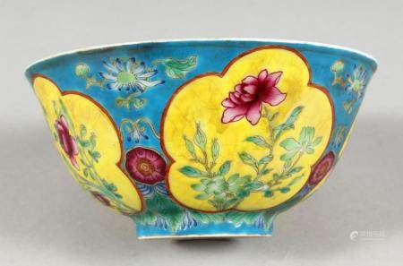 A CHINESE PORCELAIN BOWL, blue ground, painted with panels o