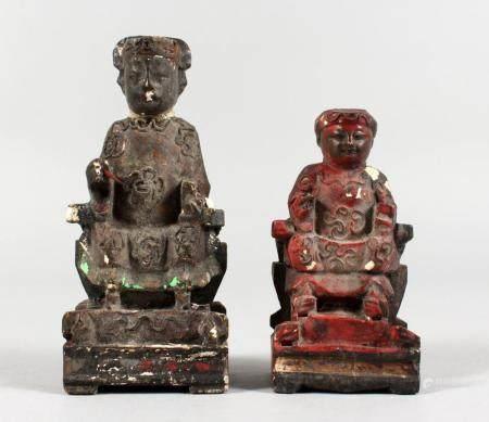 TWO SMALL CHINESE CARVED WOOD AND PAINTED SEATED FIGURES. 4.