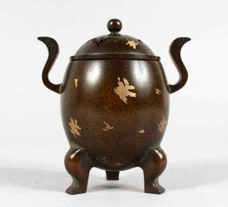 A SMALL CHINESE GOLD SPLASH TWIN-HANDLED BRONZE CENSER ON TH