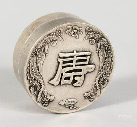 A CHINESE WHITE METAL CIRCULAR BOX. 2.5ins diameter.