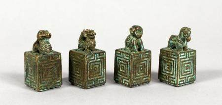 A SET OF FOUR CHINESE BRONZE SEALS. 1.5ins high.