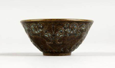 A SMALL CHINESE BRONZE CIRCULAR CENSER. 2.5ins.