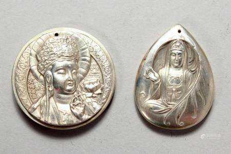 TWO CHINESE WHITE METAL PENDANTS. 2ins high.