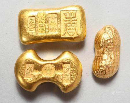 THREE NOVELTY CHINESE GOLDEN-COLOURED SCROLL WEIGHTS. 2ins a