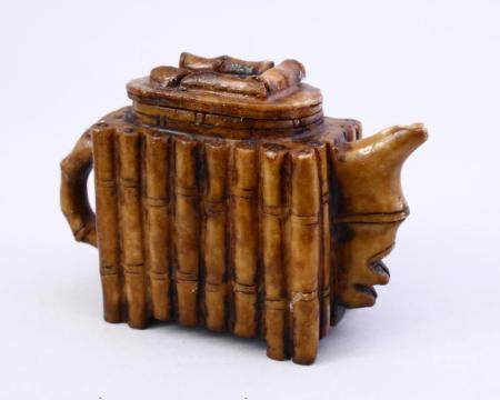 A CHINESE BAMBOO CARVED SOAP / HARD STONE TEA POT AND COVER,