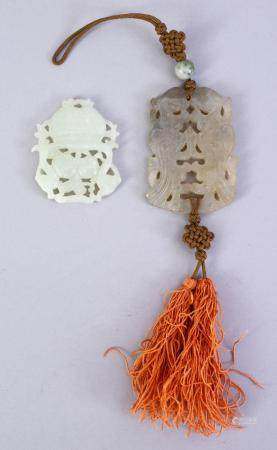 TWO CHINESE CARVED JADE / HARDSTONE PENDANTS, one depicting