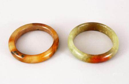 TWO 19TH / 20TH CENTURY CHINESE CARVED JADE BANGLES, both 8.