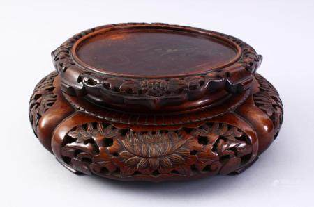 A GOOD 19TH CENTURY CHINESE CARVED HARD WOOD STAND, carved w