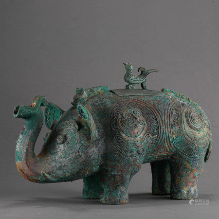 HAN DYNASTY, BRONZE ELEPHANT WITH A BIRD STANDING ON ITS BACK