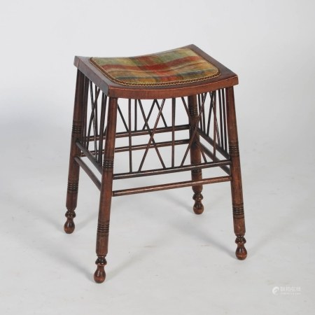 A late 19th/early 20th century stained beech dressing table stool, the concave rectangular top