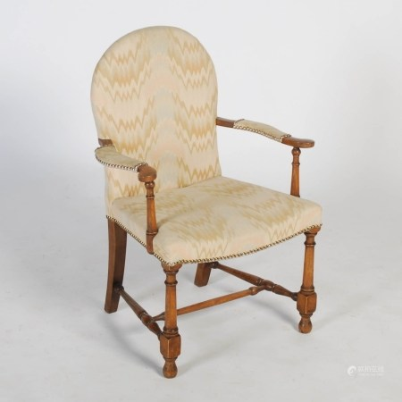 An early 20th century child's mahogany armchair, the arched back, shaped arms and seat upholstered