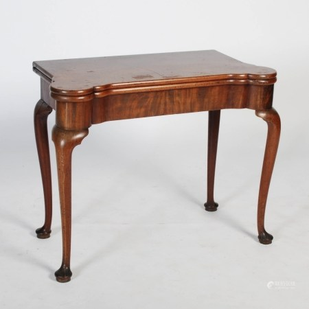 A George III mahogany concertina action card table, the hinged rectangular top opening to a green