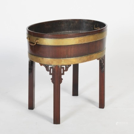 A George III mahogany and brass bound oval wine cooler, with lead lined interior and brass drop