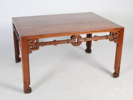 A Chinese huanghuali writing table, Qing Dynasty, the rectangular top above a pierced and scroll