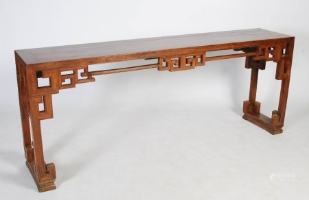 A Chinese blonde wood rectangular table, late 19th/early 20th century, the rectangular panelled