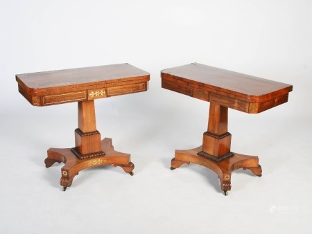 A pair of 19th century rosewood and brass inlaid pedestal card tables, the hinged rectangular tops