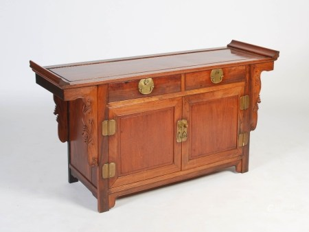 A Chinese dark wood side cabinet, Qing Dynasty, the rectangular panelled top with slightly raised