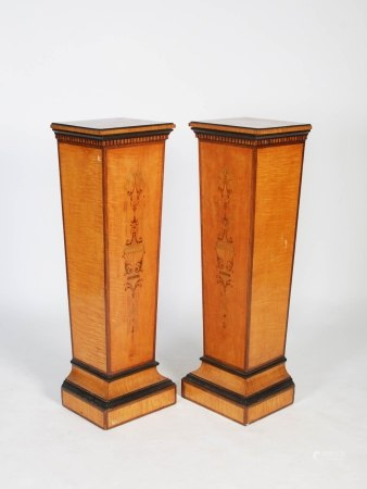 A pair of late 19th century satinwood, ebonised and marquetry inlaid pedestals, the rectangular tops