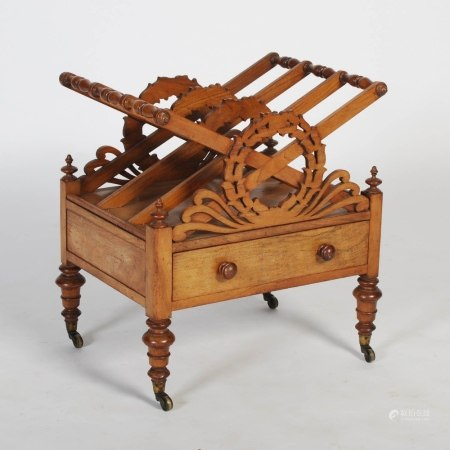 A 19th century mahogany Canterbury, the rectangular top with three divisions and pierced laurel