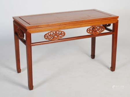 A Chinese rectangular table, 20th century, the rectangular panelled top above an open frieze set