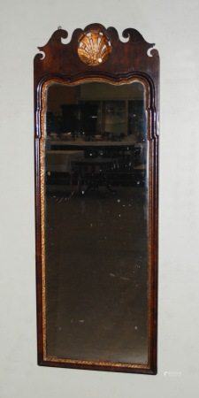A George II style mahogany and parcel gilt fret cut wall mirror, with pierced and carved Prince Of