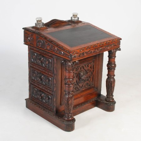 A Victorian oak Davenport, the rectangular top with two division letter rack and two facet cut glass