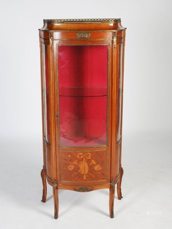 A late 19th century French mahogany, marquetry and gilt metal mounted vitrine, the shaped top with a