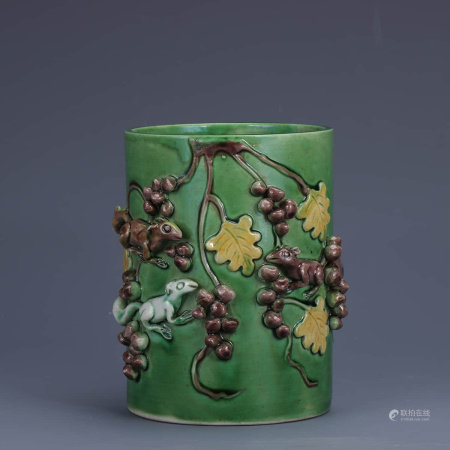 A Chinese Green Glazed Relief Porcelain Brush Pot