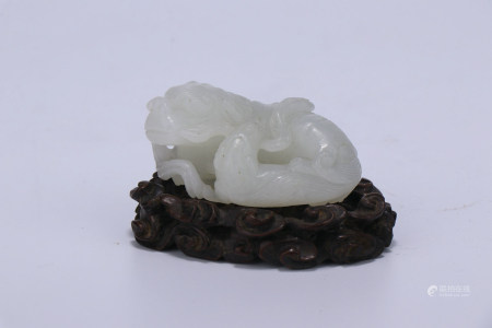 A Chinese Carved Jade Foo-Dog