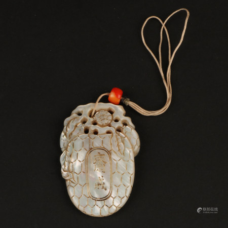 A Chinese Carved Mother of Pearl Fasting Pendant
