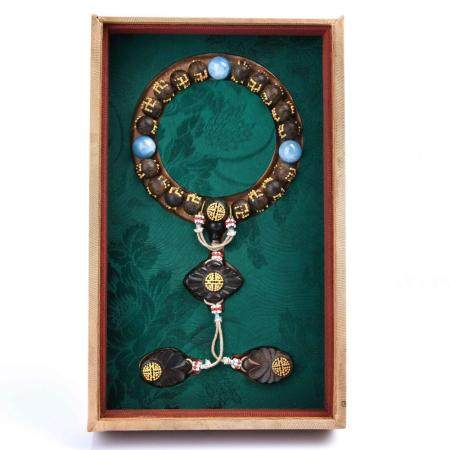A GOLD-INLAID AGALLOCH WOOD BRACELET