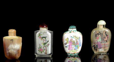 A small collection of four Chinese snuff bottles of various