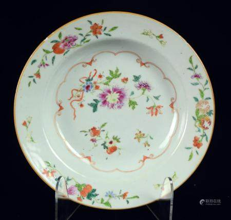 A Chinese famille rose soup plate with flowers and fruits, Q