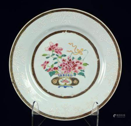 A rare famille rose Chinese plate with basket of peony flowe